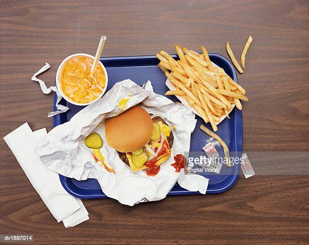elevated view of a tray with fries, a hamburger and lemonade - take away food stock pictures, royalty-free photos & images