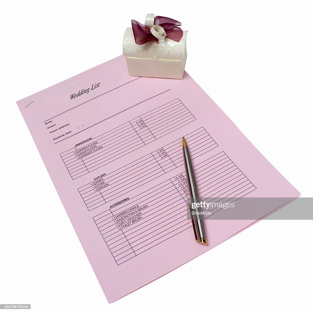 Elevated view of a wedding list and a pen and a gift : Stock Photo