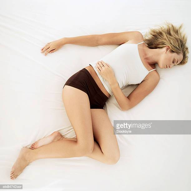elevated view of a woman sleeping in bed