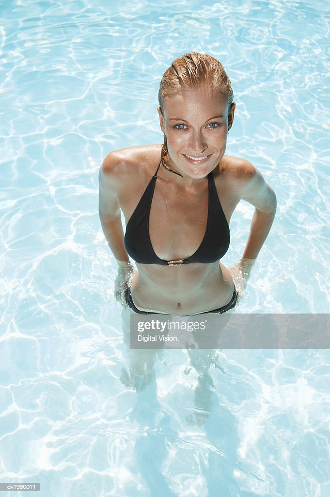 Elevated View of a Woman Standing in a Swimming Pool : Stock Photo