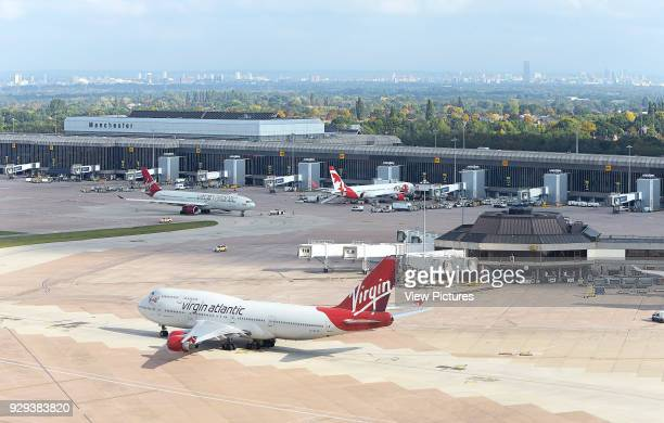 Elevated view of airport with Manchester cityscape beyond Manchester Airport Manchester United Kingdom Architect n/a 2015