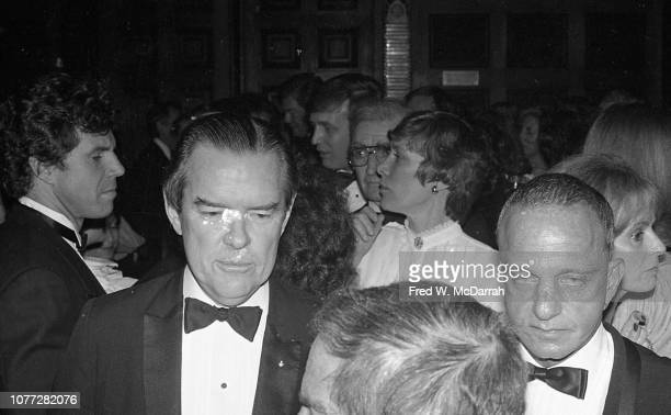Elevated view of American attorneys and law partners Tom Bolan and Roy Cohn during Cohn's birthday party at the Seventh Regiment Armory New York New...