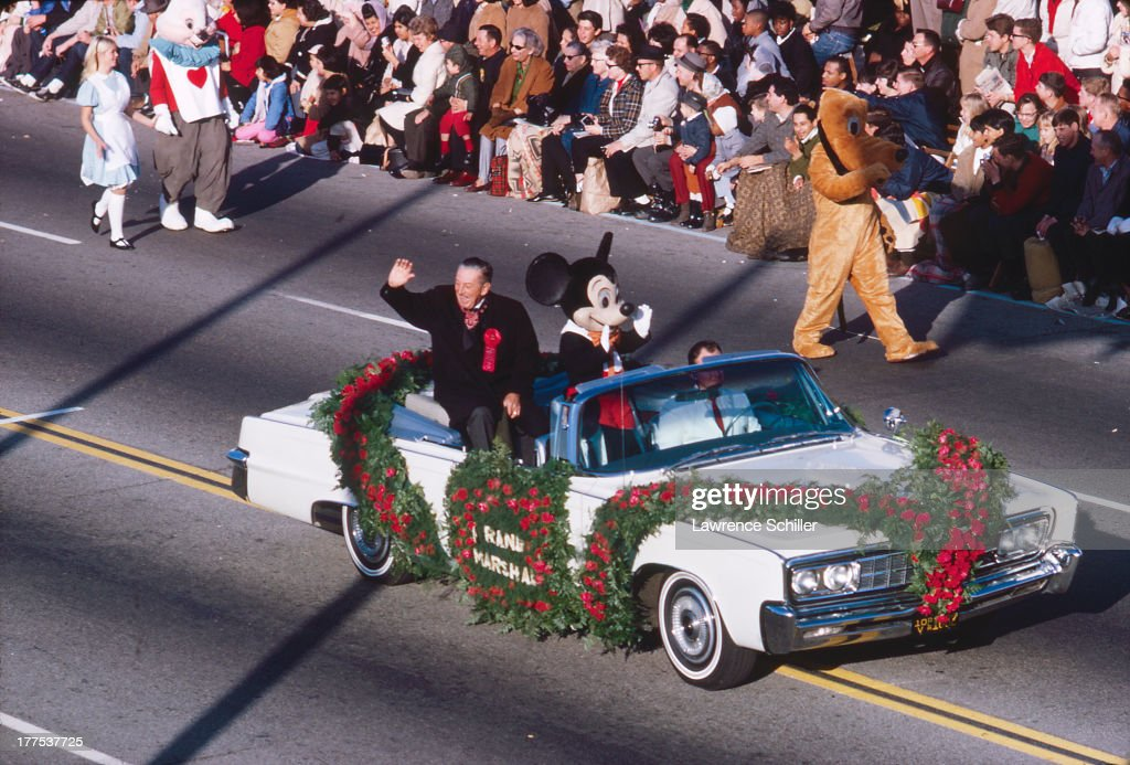 Elevated view of American film animator, director, and producer Walt Disney (1901 - 1966) as he leads the Tournament of Roses Parade, with Mickey Mouse, as the event's Grand Marshal, Pasadena, California, 1966.