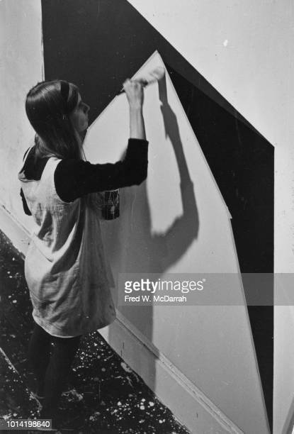 Elevated view of American painter Tamara Melcher as she paints in her downtown loft studio New York New York November 14 1965