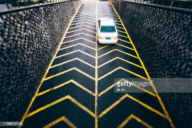 elevated view of an automobile driving on uphill road - uphill stock pictures, royalty-free photos & images