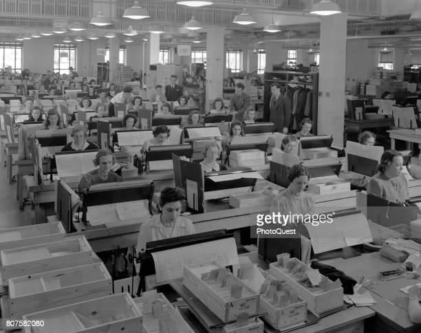Elevated view of an office of card punch operators as they tabulate the US population in the 1940 Census Washington DC 1940 More than 2400 women were...