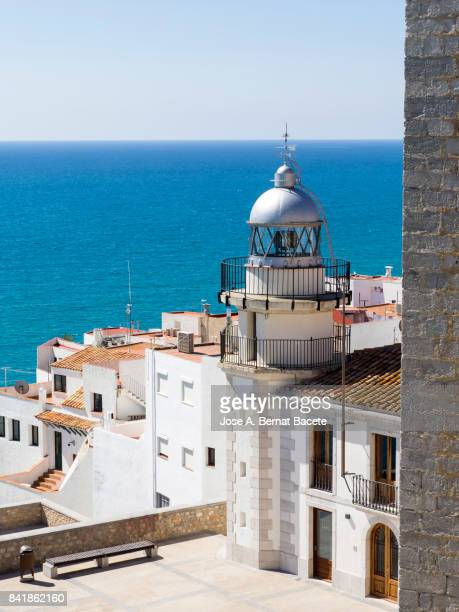 Elevated view of an old lighthouse with the metal dome, in the city of Peñiscola, Costa Blanca, Castellon, Spain