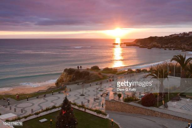 elevated view of beach and sea at sunset - faro stock photos and pictures