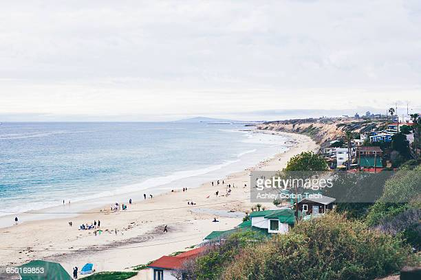elevated view of beach huts and distant tourists on beach, crystal cove state park, laguna beach, california, usa - laguna beach california stock pictures, royalty-free photos & images