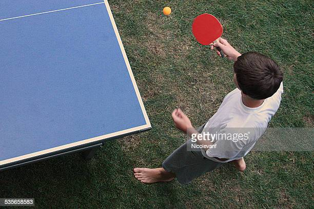 Elevated view of boy playing table tennis