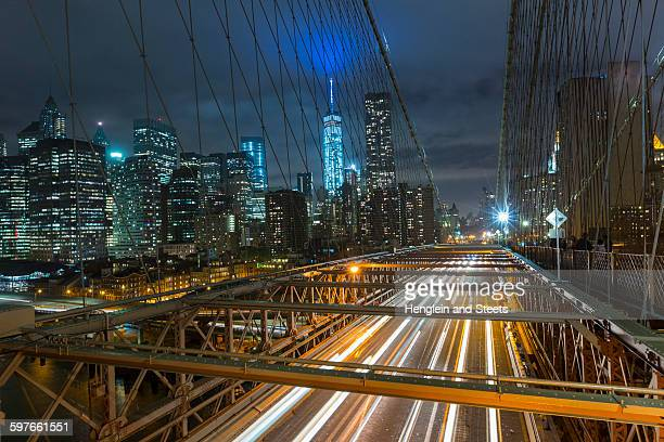 Elevated view of Brooklyn bridge and Manhattan financial district skyline at night, New York, USA