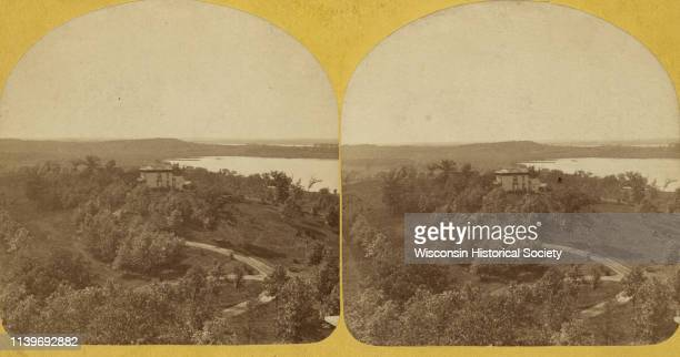 Elevated view of building on the University of Wisconsin-Madison campus, which is located on a hill near Lake Mendota, Madison, Wisconsin, 1876. A...