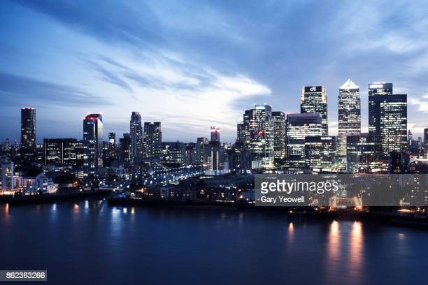 elevated view of canary wharf in london - canary wharf stock photos and pictures