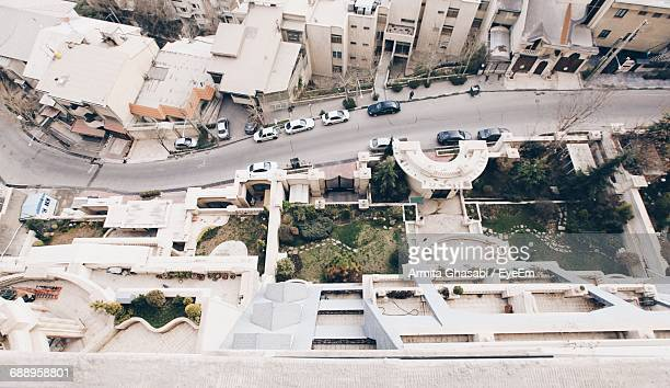Elevated View Of Cars On Road By Buildings