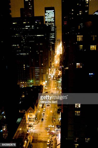 elevated view of chicago main road, traffic and scyscrapers at night-time - sarri stock pictures, royalty-free photos & images