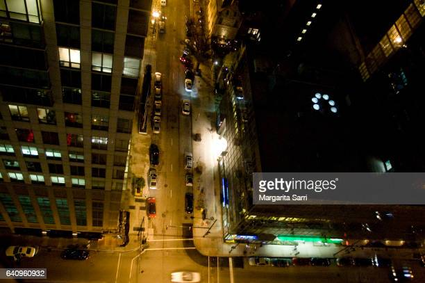 elevated view of chicago road and scyscrapers at night-time - sarri stock pictures, royalty-free photos & images