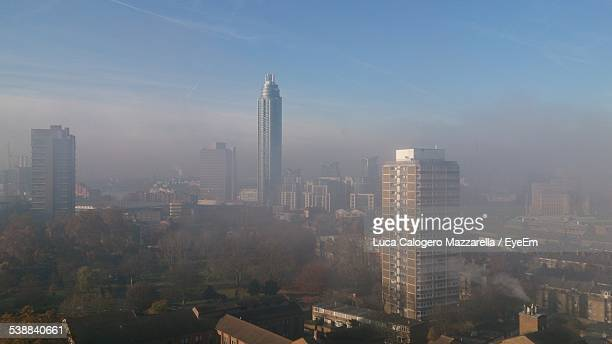 Elevated View Of Cityscape In Smog