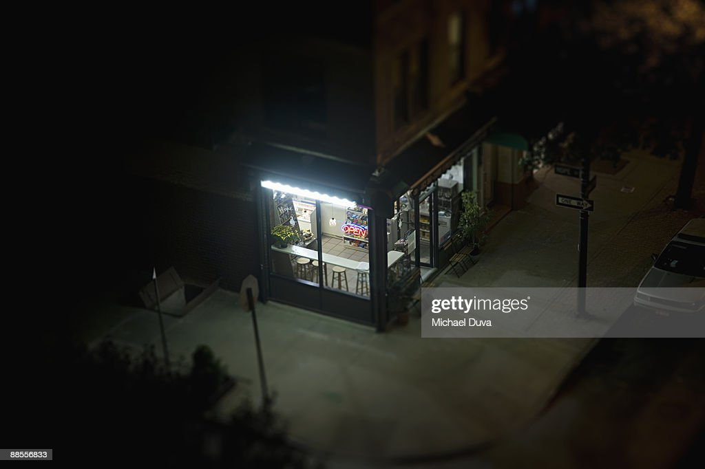 elevated view of corner deli in urban area : Bildbanksbilder