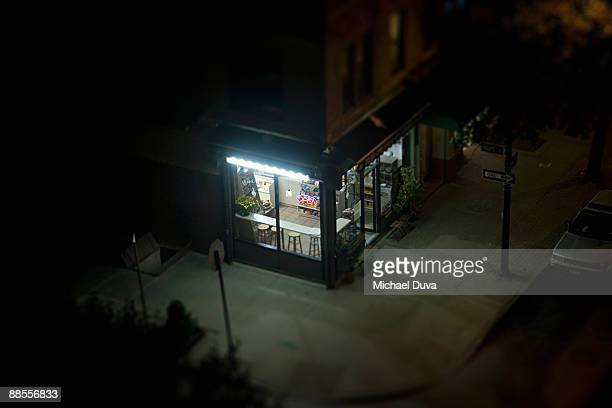elevated view of corner deli in urban area - fluorescent light stock pictures, royalty-free photos & images