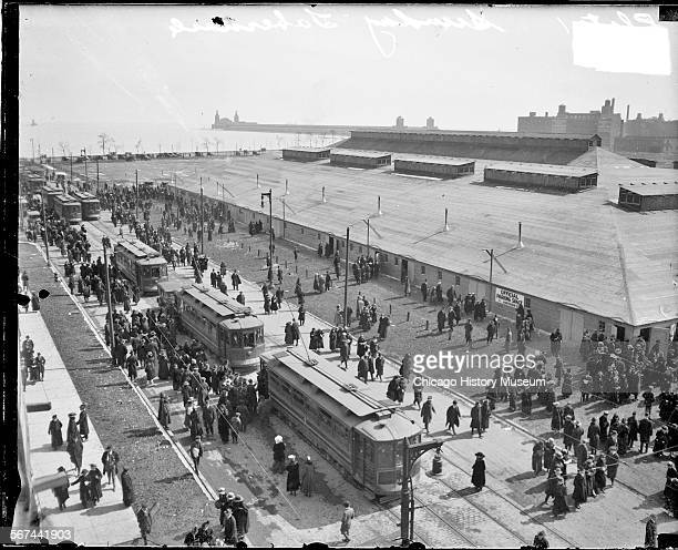 Elevated view of crowd outside revival tent called a tabernacle set up for evangelist Billy Sunday just north of Navy Pier in the Near North Side...