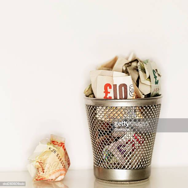 Elevated view of crumpled euro bank notes in rubbish bin