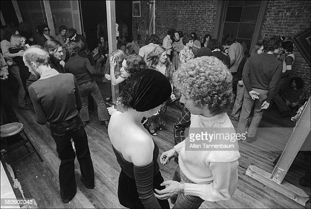 Elevated view of dancers at a loft party in SoHo New York New York January 9 1974 A bodega is in the background
