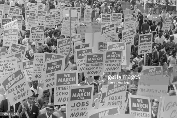 Elevated view of demonstrators many of whom carry signs during the March on Washington for Jobs and Freedom Washington DC August 28 1963 Among the...