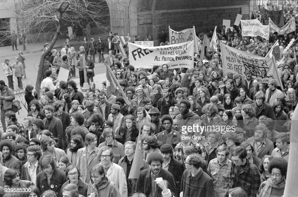 Elevated view of demonstrators many with banners and flags on East 59th Street as they approach the walkway of the Queensboro Bridge during a...