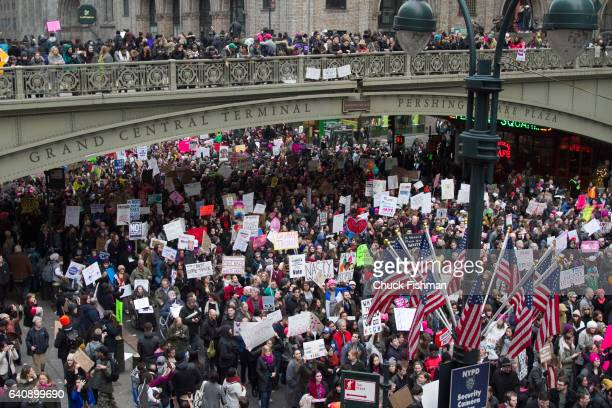 Elevated view of demonstrators many with signs during the Women's March on New York as they cross under the Park Avenue Viaduct on 42nd Street New...