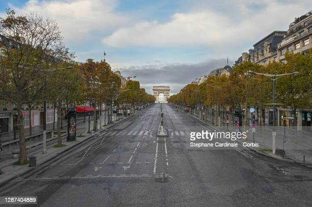 Elevated view of deserted Champs-Elysees Avenue with background of the Arc de Triomphe during France's second Lockdown on November 08, 2020 in Paris,...