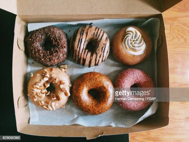 Elevated view of donuts in box