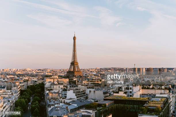 elevated view of eiffel tower and paris skyline at sunset in summer , france . - paris rocks stock pictures, royalty-free photos & images