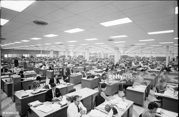 Elevated view of employees as they process tax returns at a regional IRS office Philadelphia Pennsylvania March 11 1965