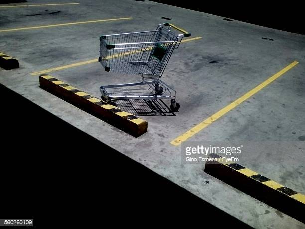 Elevated View Of Empty Shopping Cart On Parking Lot