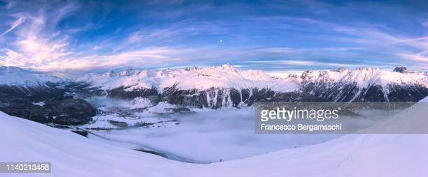 Elevated view of Engadine valley at sunrise. Canton of Grisons, Switzerland, Europe.