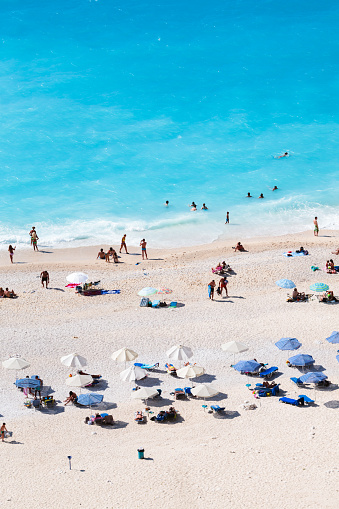 Elevated view of famous Myrtos beach crowded with tourists in summer, Greece - gettyimageskorea