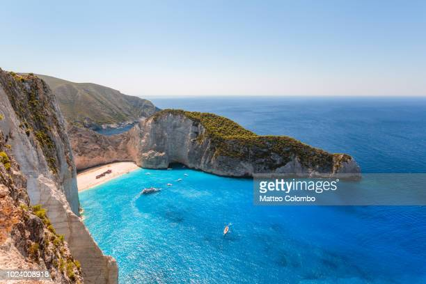 elevated view of famous shipwreck beach. zakynthos, greek islands, greece - international landmark stock pictures, royalty-free photos & images