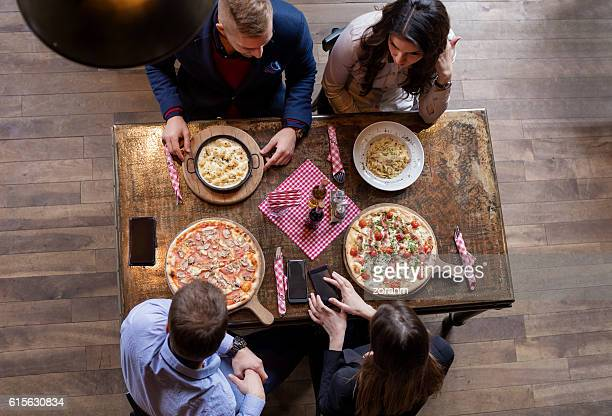 Elevated view of friends eating pizza