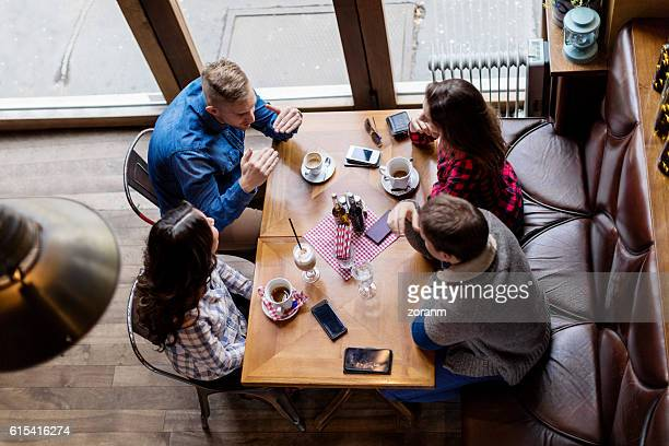 Elevated view of friends in cafe