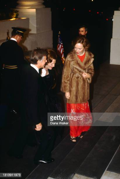 Elevated view of, from fore left, US President Jimmy Carter, UK Prime Minister Margaret Thatcher, and First Lady Rosalynn Carter as they arrive at...