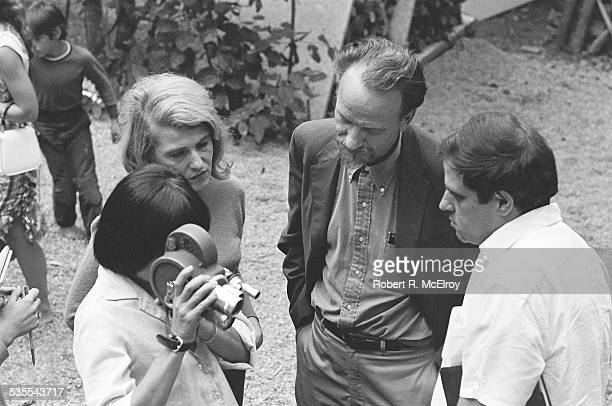 Elevated view of, from left, French filmmaker Agnes Varda , film critic Annette Michelson, filmmaker Ed Emshwiller , and an unidentified figure as...