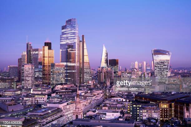 elevated view of futuristic london skyline at dusk - night stock pictures, royalty-free photos & images