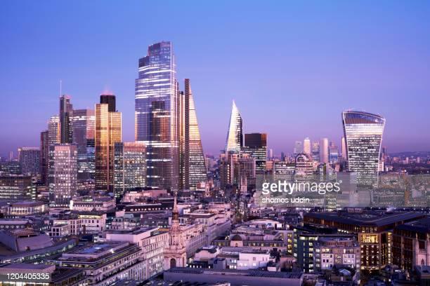 elevated view of futuristic london skyline at dusk - city of london stockfoto's en -beelden