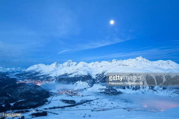 Elevated view of high Engadine at dusk. Engadine valley, Canton of Grisons, Switzerland, Europe.