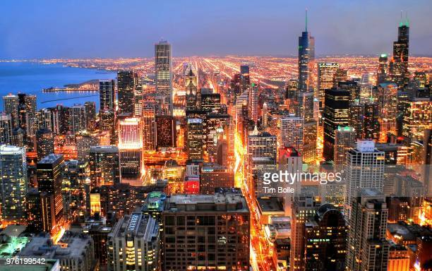 elevated view of illuminated city, chicago, illinois, usa - cook county illinois stock photos and pictures