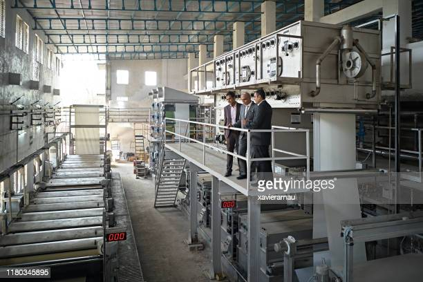 elevated view of indian ceo and senior factory managers - industrial equipment stock pictures, royalty-free photos & images