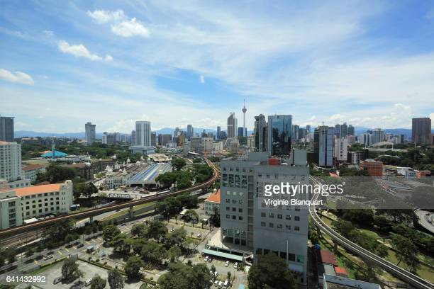 elevated view of kuala lumpur with the menara kl in the morning - menara kuala lumpur tower stock photos and pictures