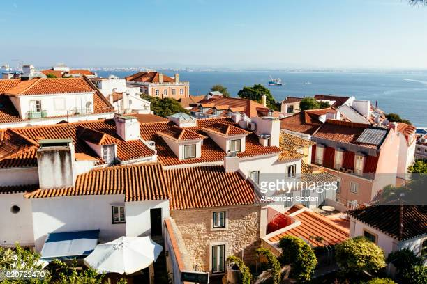 elevated view of lisbon and the sea - alfama stock photos and pictures