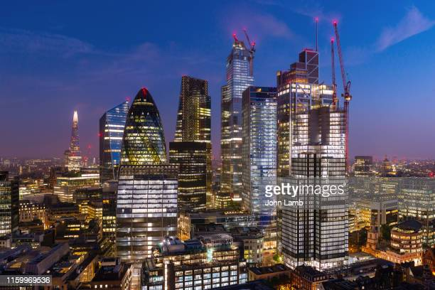 elevated view of london's financial district at night. - london skyline stock pictures, royalty-free photos & images