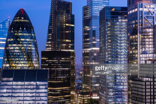 elevated view of london's financial district at night. - city stock pictures, royalty-free photos & images